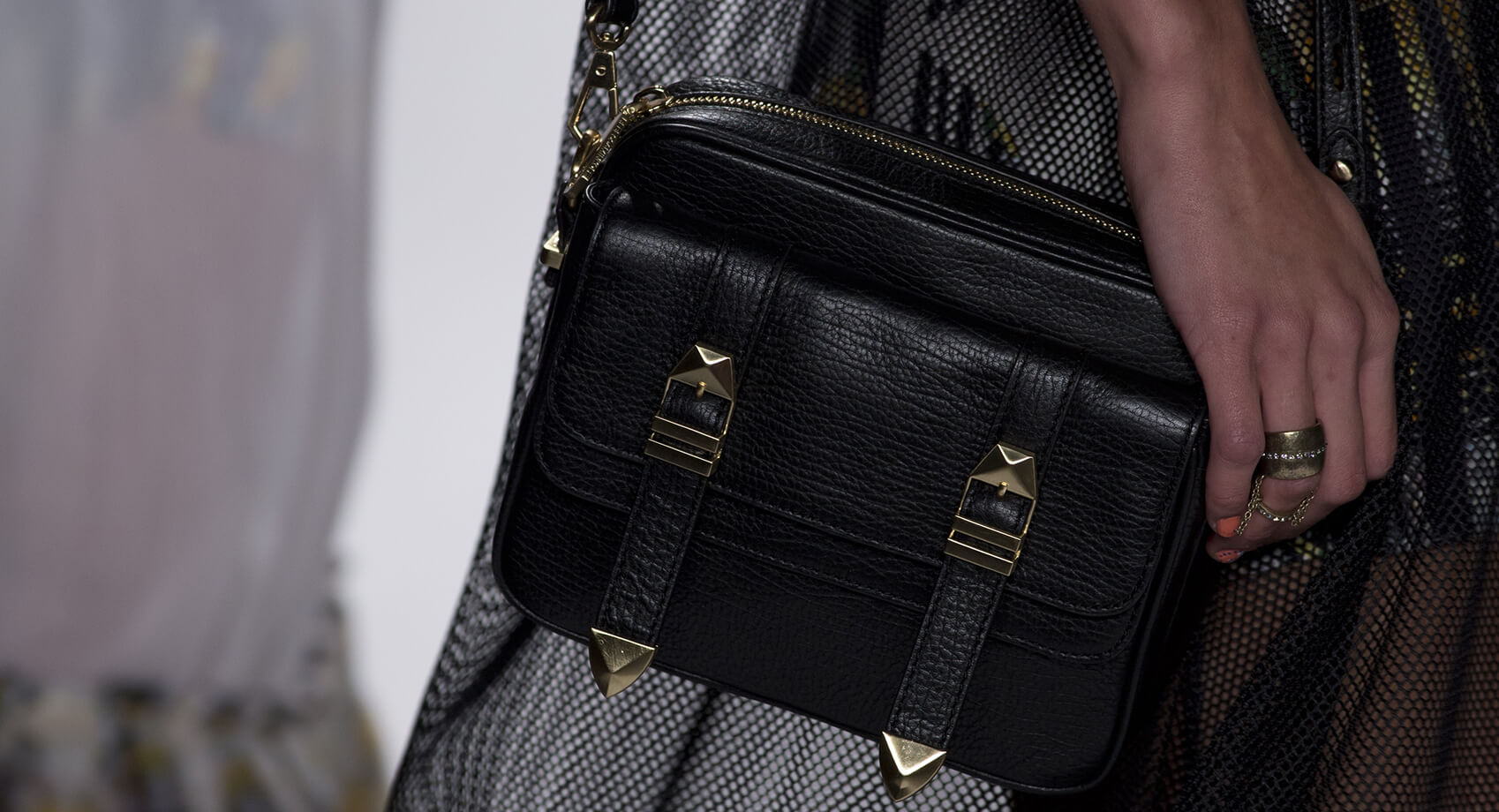 Black leather handbagwith golden buckles