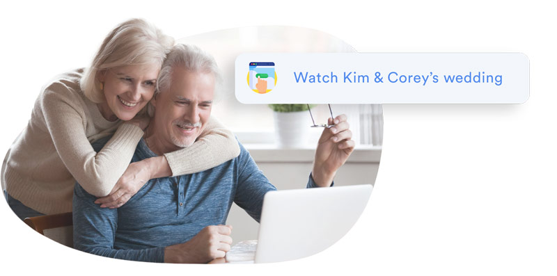 elderly couple watching a wedding live stream