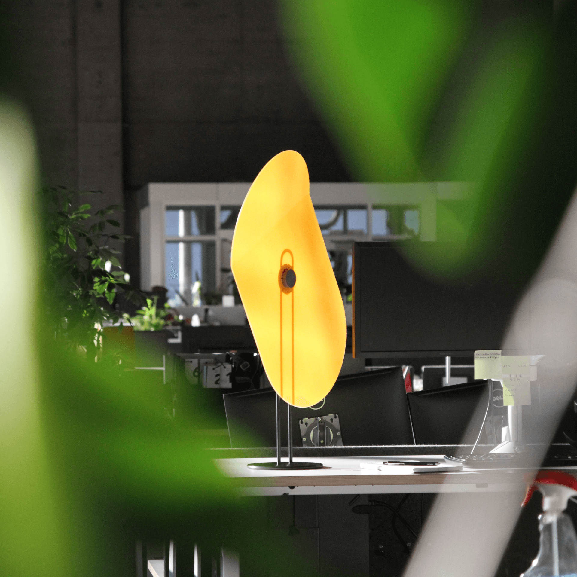 A glowing yellow Taskshade in the center of a photograph.