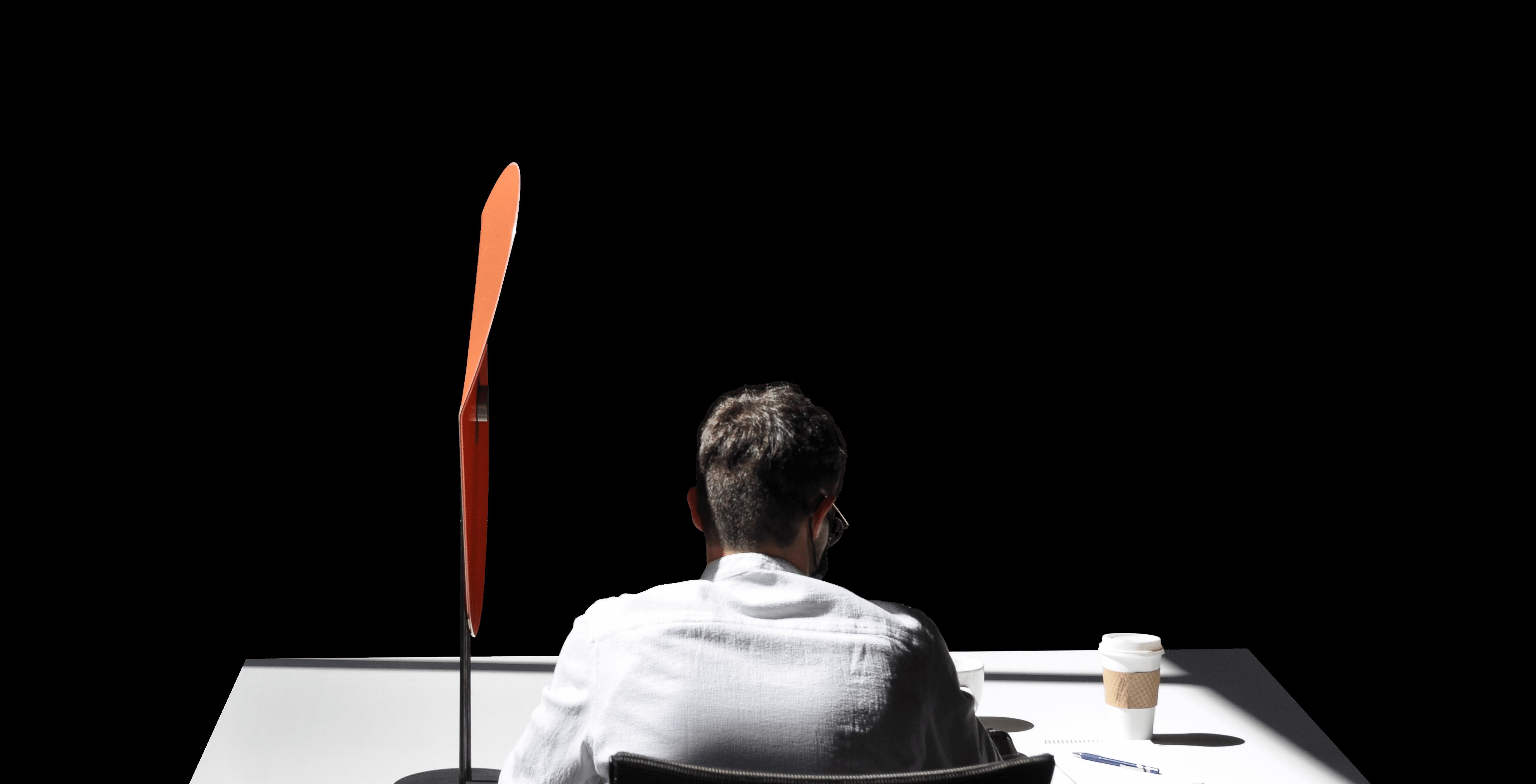 A man sitting at a desk with a Taskshade.