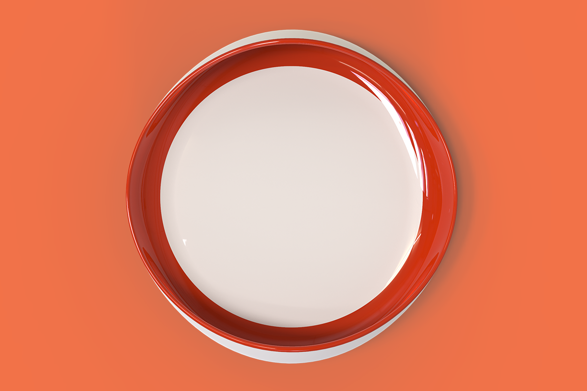 A top view of a cream coloured dish with a  dark red painted interior on a light red background.