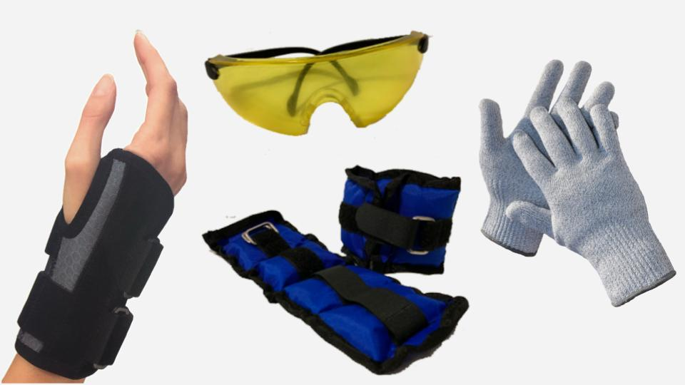 Simulation devices depicting a black and grey wrist brace on a single hand, yellow goggles with a scratched surface finish, long weights with straps, and thick grey gloves.