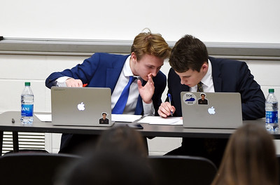 Morgan Swigert and Jack Johnson in the middle of a debate round.