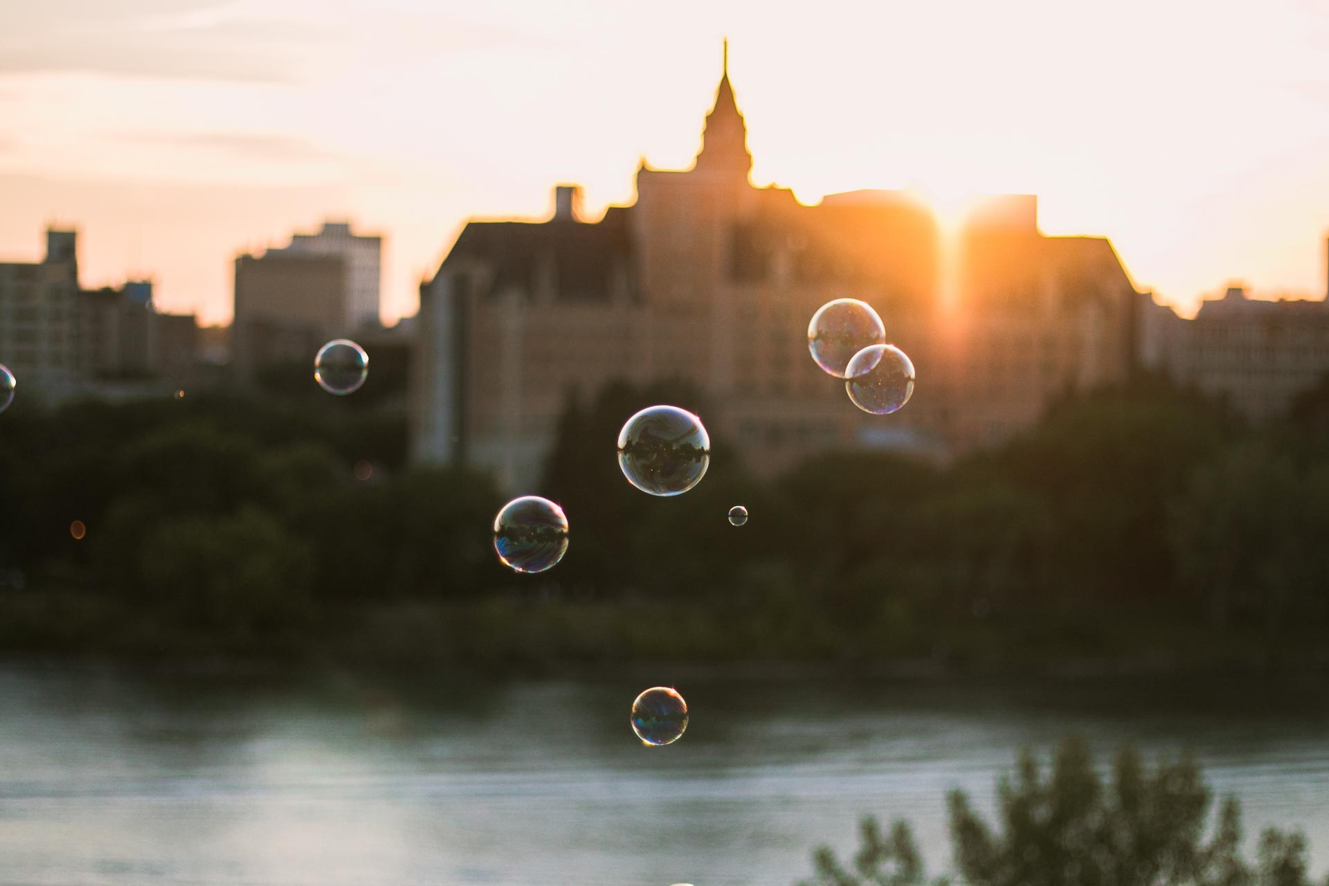 The Bessborough in Saskatoon in the distance across the water with bubbles in focus in the foreground.