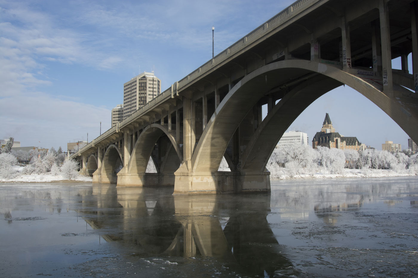 Broadway Bridge in Saskatoon during the winter with the Bessborough framed underneath one of the spans.