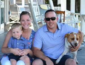 Enjoying a much-needed break from Boston last summer, Carolyn Souza, RN, relaxes with son, Colin, husband, Mike, and fur baby, Huey.