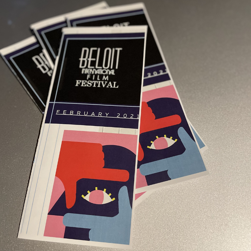Photo of stacks of sponsorship brochure created by Owl Street Studio for Beloit International Film Festival