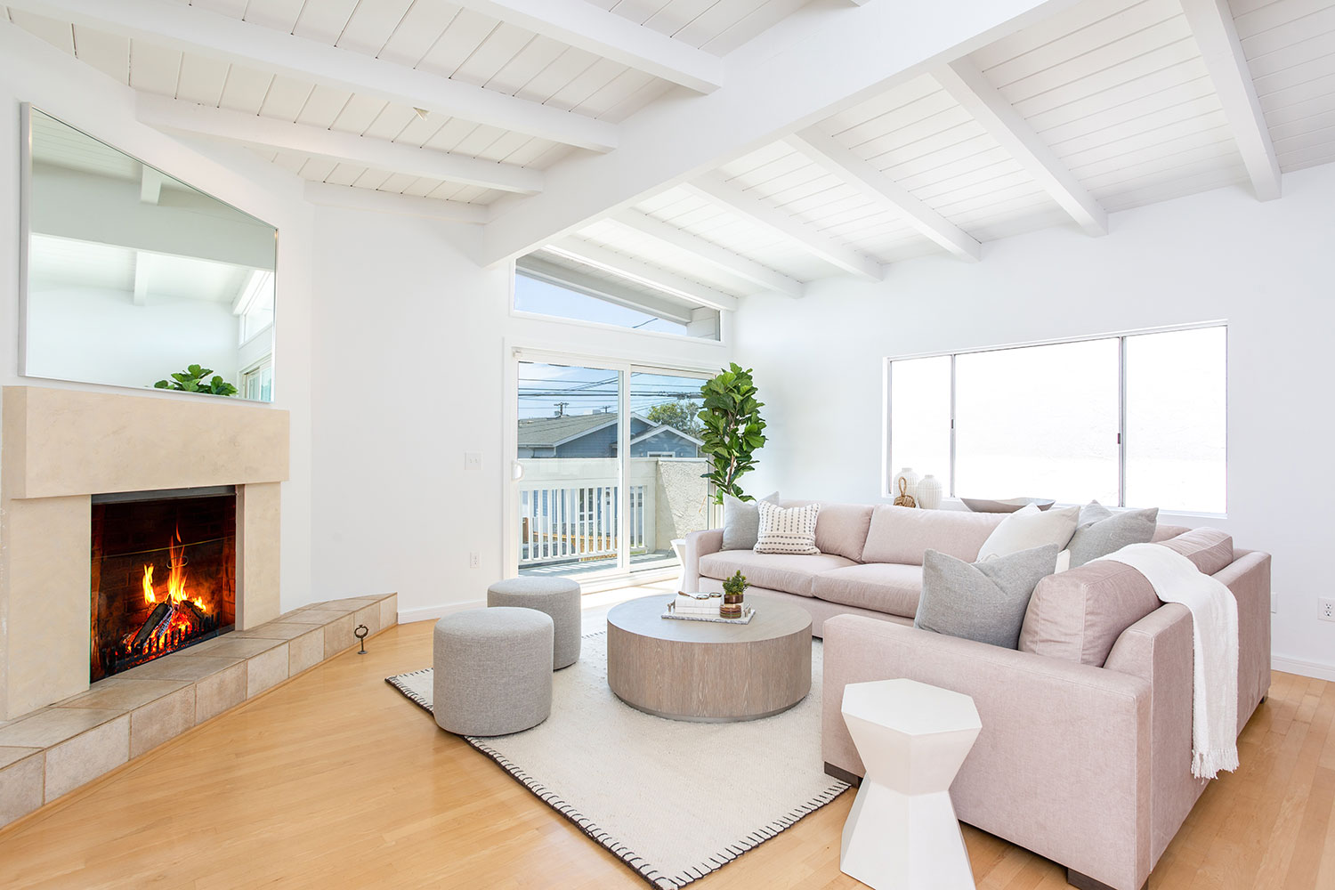 bright neutrals living room with fireplace