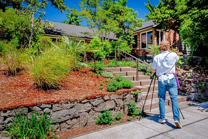 Eric photographing a home on a sunny day