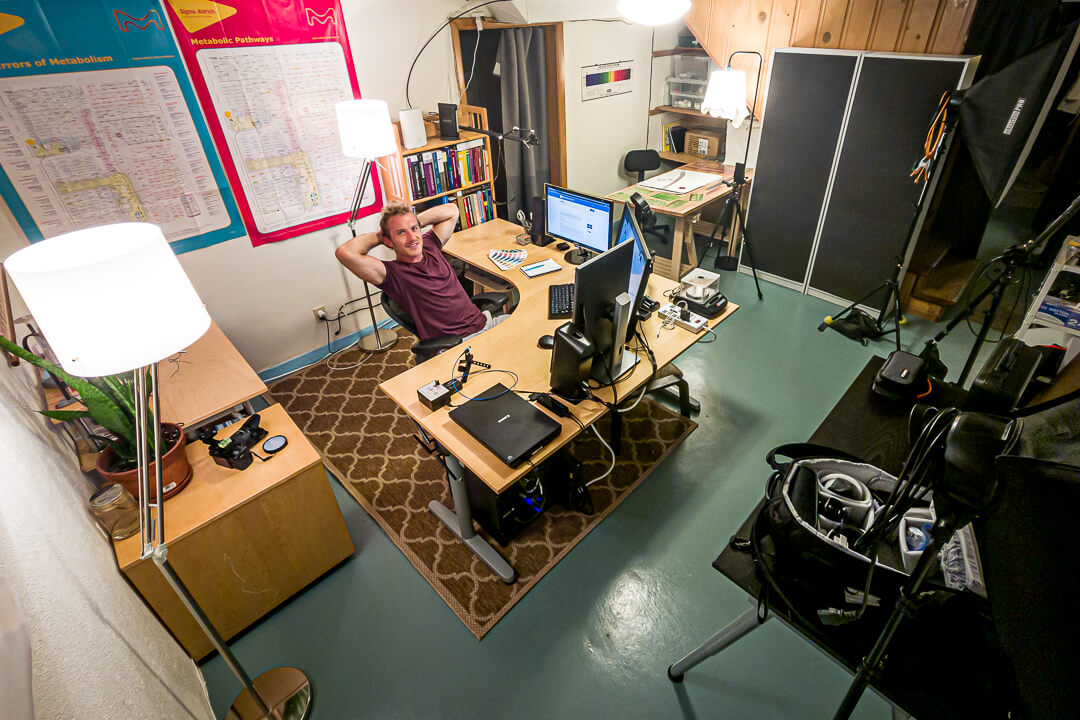 Eric in his home office surrounded by photographic and scientific equipment