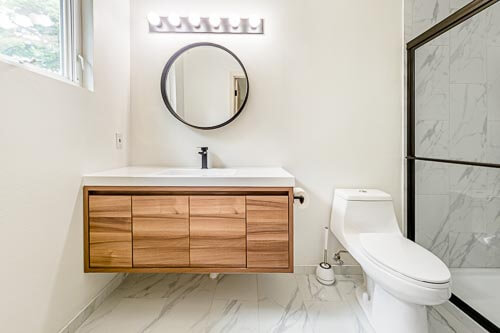 Master bedroom bathroom with wood cabinets and vanity