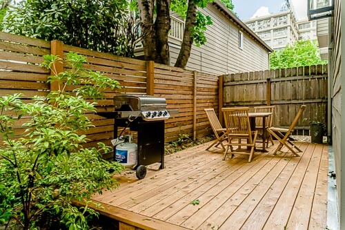 Backyard porch with gas grill