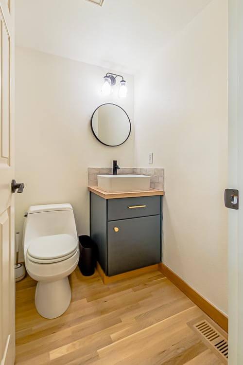 Bathroom with wooden floor and vanity