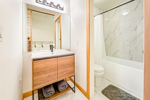 Private bathroom from bedroom with vanity