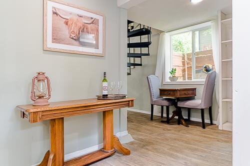 Entryway with hallway table and mini dining table in basement