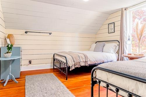 Twin beds in bedroom of second floor Airbnb