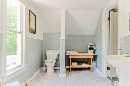 Bathroom with bright window and blue paint in Airbnb