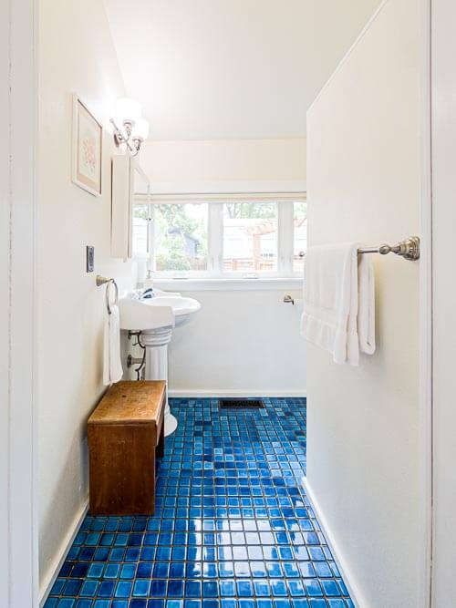 Bathroom with blue tile and vanity