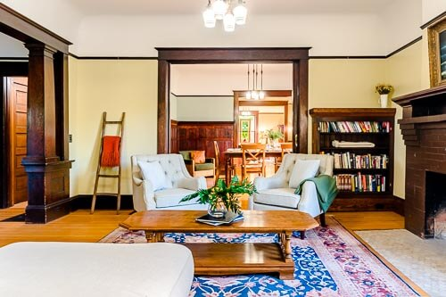 Living room with chairs, couch and rug