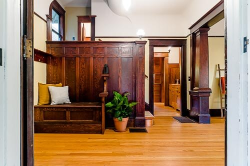 Entry way into historic home with dark wood staircase