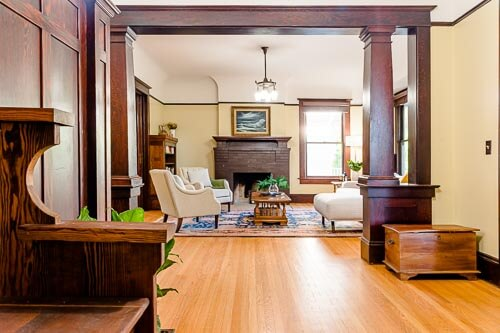Living room entryway with wood beams