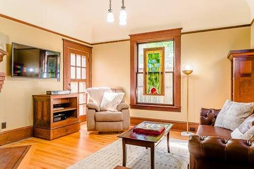 First floor lounge and TV room with hardwood trim