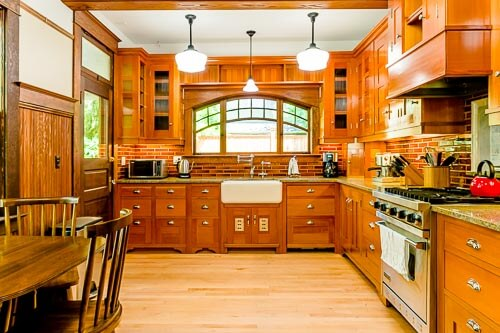 Kitchen with rich wood cabinets and farmhouse sink