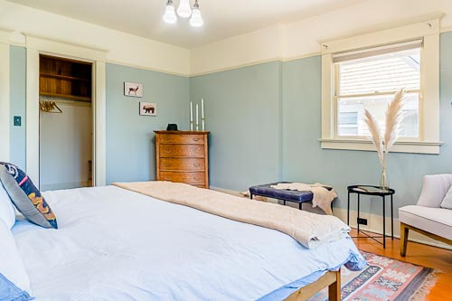 Bedroom with bed and wooden dresser
