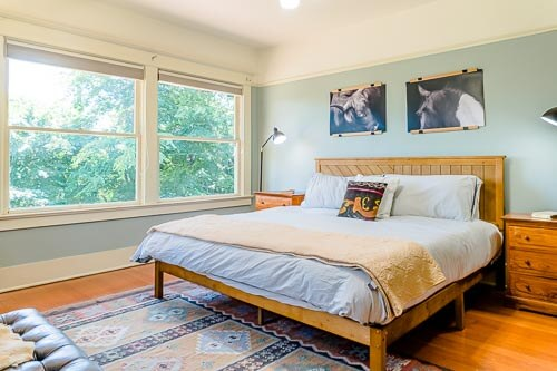Bedroom with blue paint and bright windows
