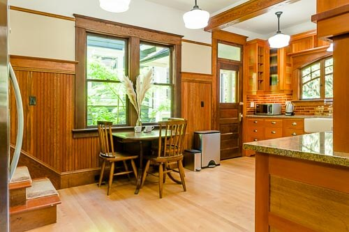 Kitchen with rich hardwood cabinetry