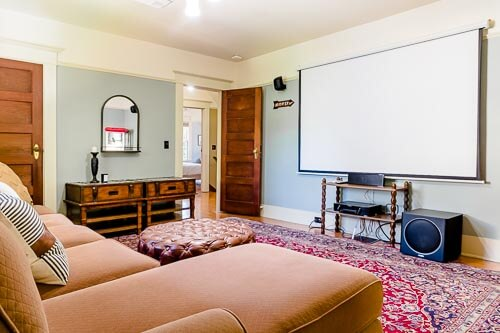 Movie room with couch and projector screen
