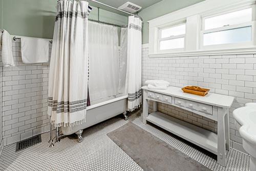 Bright clean bathroom with claw feet bathtub