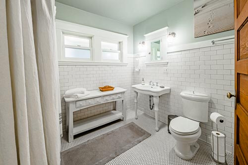 Bathroom with green paint and white tiles