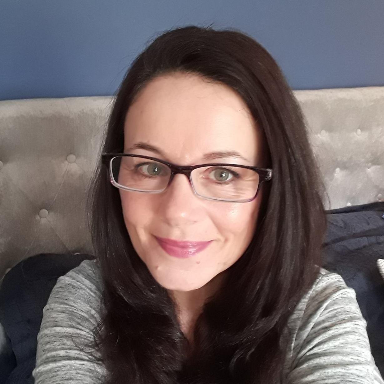 Adrienne Hodges - Freelance Web Designer - dark hair, glasses and a smile
