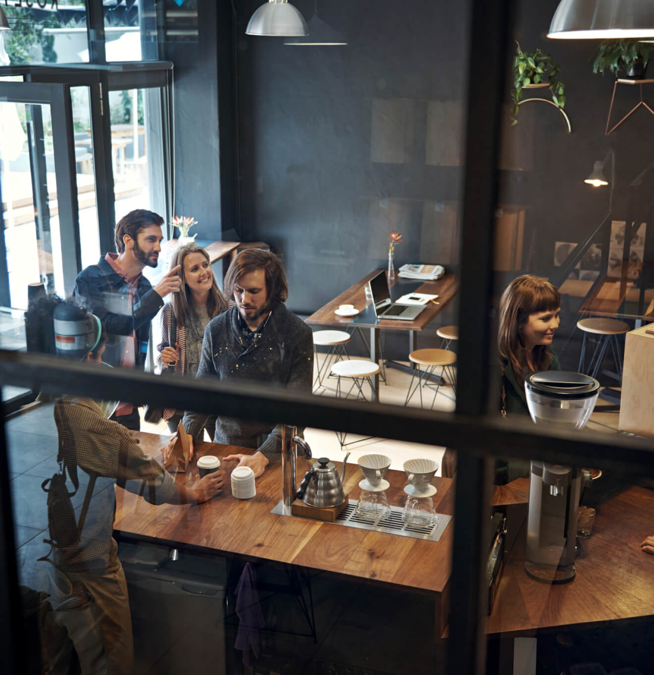 People buying at a coffee shop