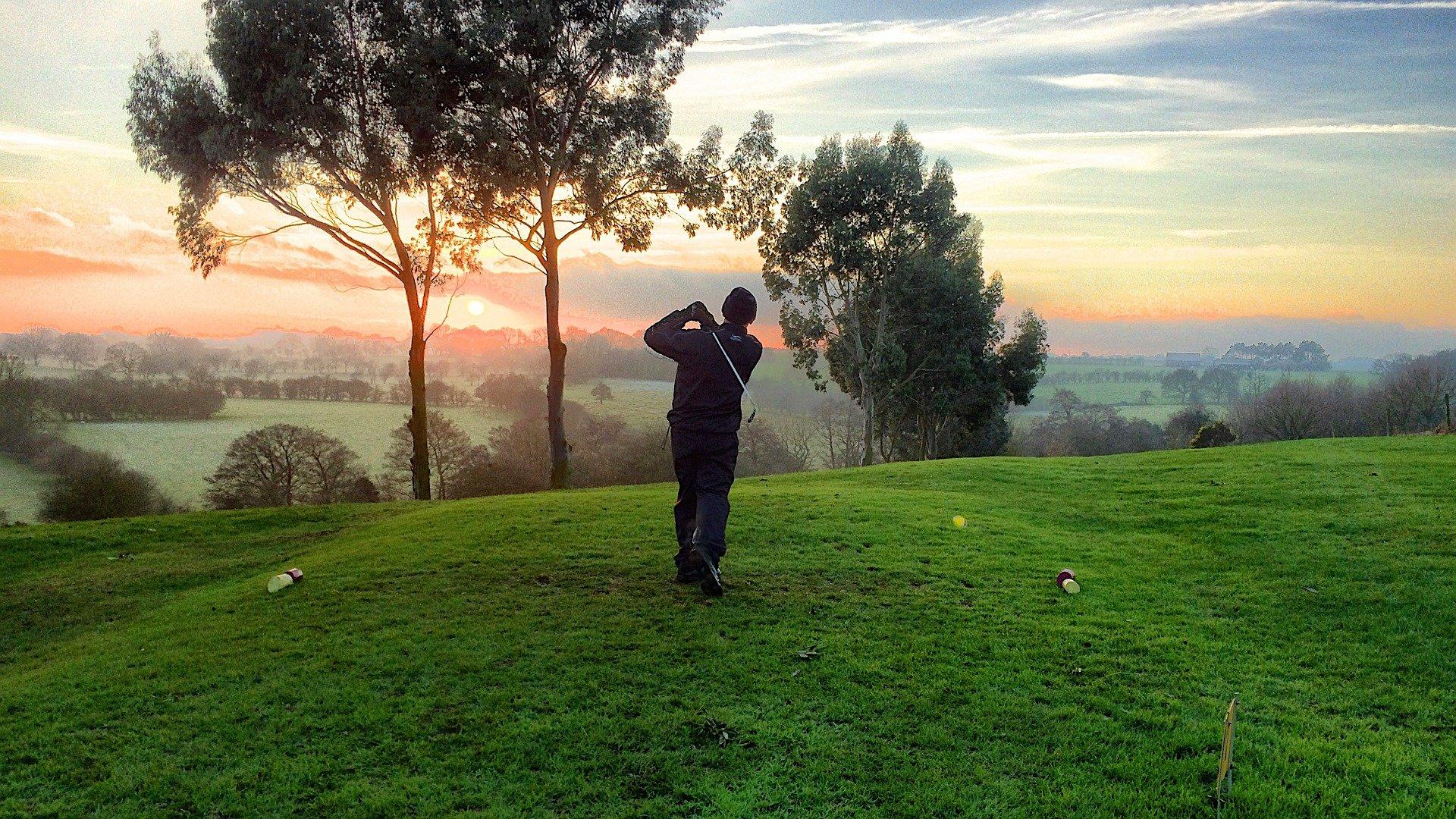 Golfer at sunrise