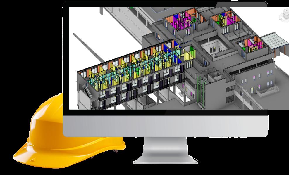 écran ordinateur et casque de chantier à côté