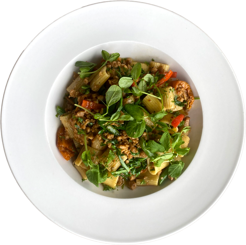 Rasta Pasta | Red Peppers, Green Beans, Marinated Yellow Sundried Tomatoes, Plant-Based Sausage, Arugula, Rigatoni, Vegetable Broth