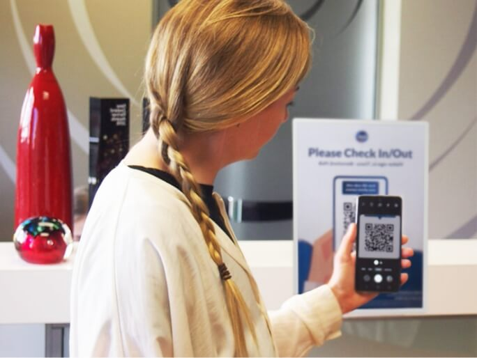 Lady scanning QR code with phone.