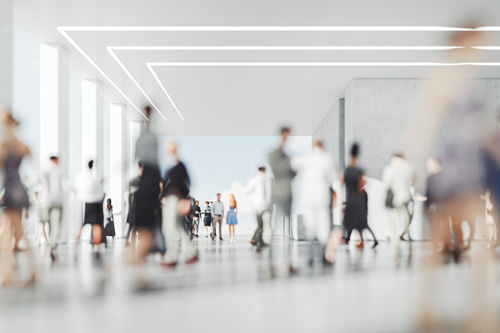 Photo of people moving around a workplace.