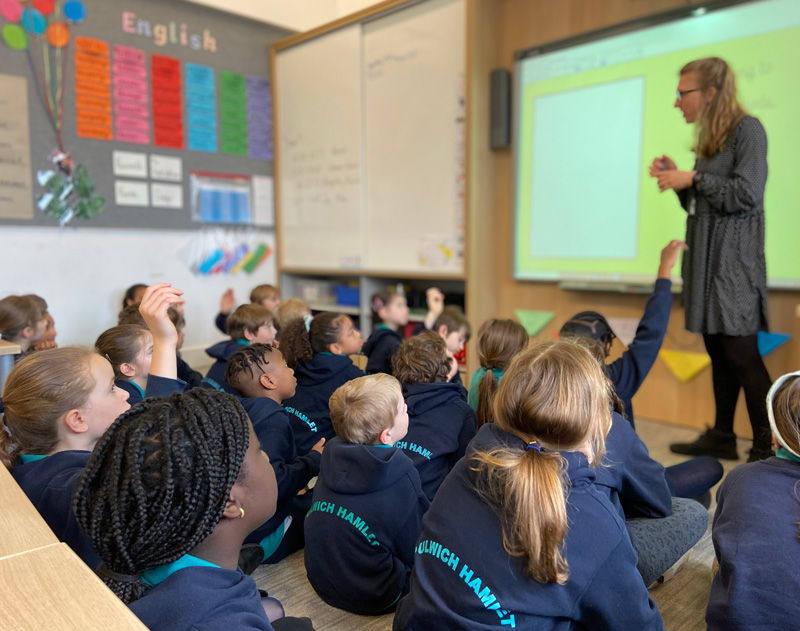 Teacher teaching from the front of her class at Dulwich Hamlet
