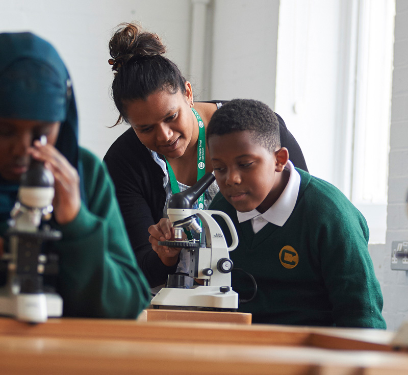Teacher supporting student at Charter School East Dulwich