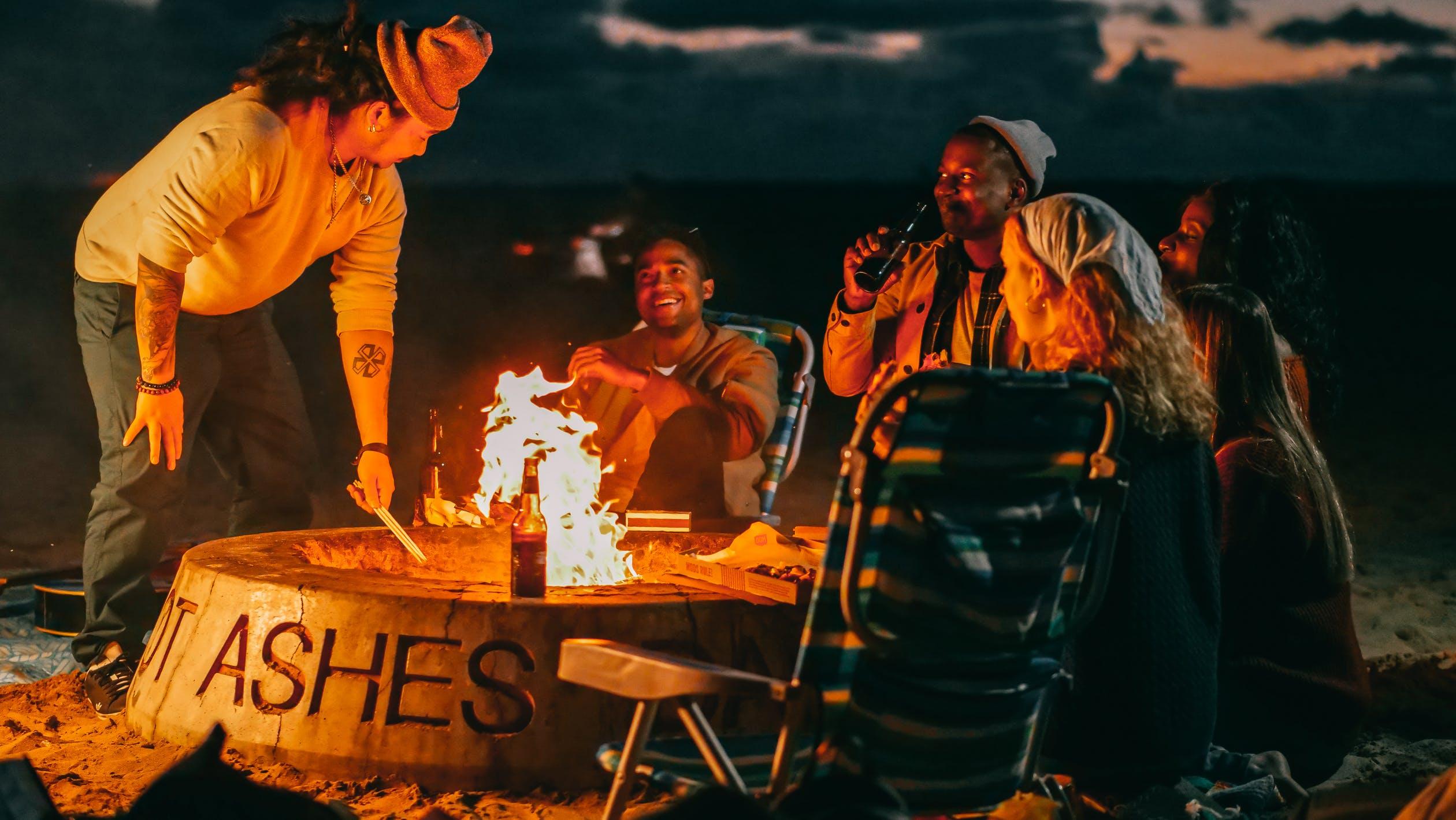 People gather around a bonfire