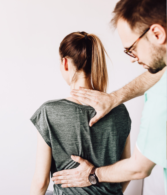 A physiotherapist working on the back of a patient