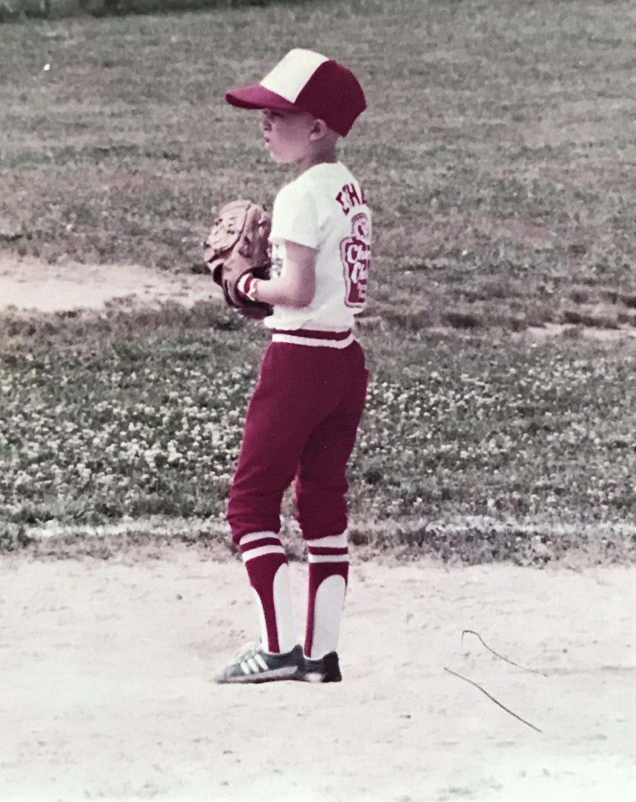 A kid wearing a baseball gloveDescription automatically generated with low confidence