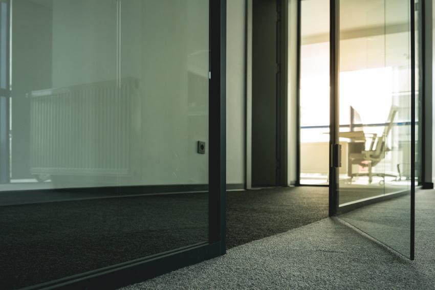 Carpet beside glass door.