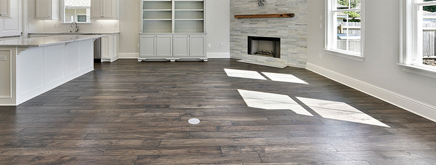 Hardwood floor with a fireplace.