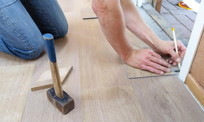 A man installing floor.