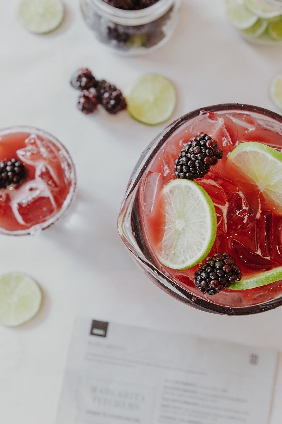 Blackberry Margarita pitcher with Lime Wheels and Blackberries as garnish.