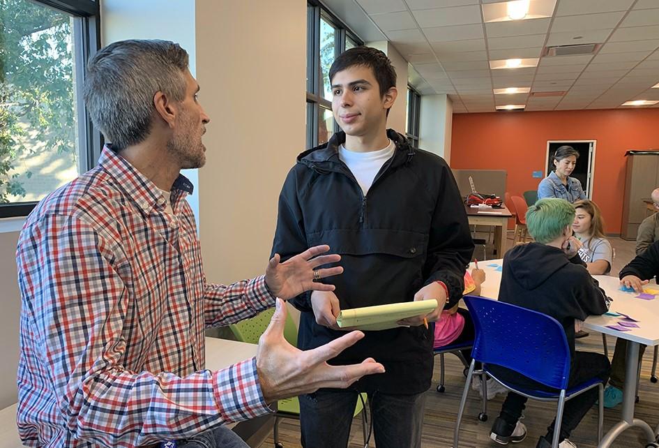 Jonathan Rodriguez/ Rodzjon/ Jon Rodz talking to a USAA UX Designer